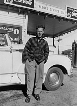 Roger Talbot in front of his father's service station